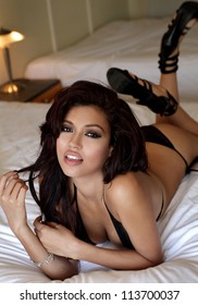 Sensual portrait of beautiful lingerie female model on bed