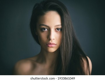Sensual portrait of a beautiful young woman with straight long hair. Beauty portrait of an attractive model