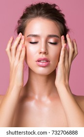 Sensual portrait over pink background