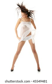 Sensual portrait of young beautiful caucasian woman in white lingerie dancing with wind. Isolated on white