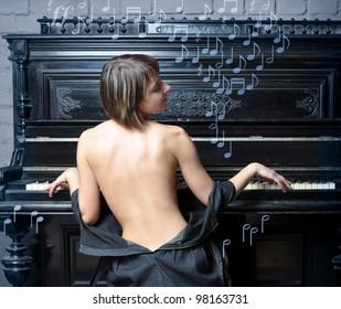 Sensual semi-dressed woman performing romantic music on piano, music symbols