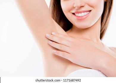 Sensual sensitive pampering concept. Cropped close up photo of charming smiling beautiful lady tenderly gently touching her flawless soft skin on the armpit isolated on white background