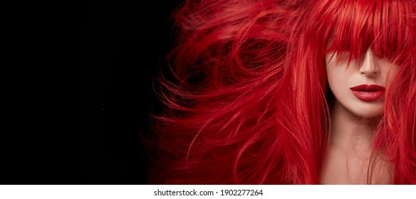 Sensual sexy beauty portrait of a red haired young woman with a healthy shiny long hair in a perfect red hair color. Closeup portrait banner isolated on black background