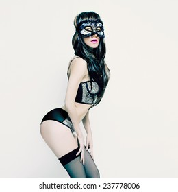 Sensual sexy Brunette in Moulin Rouge style Carnival party