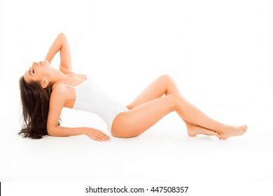 Sensual sexy slim woman showing her body in underwear