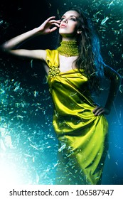 sensual sexy woman in green dress and broken glass