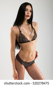 Sensual sexy woman wearing black lingerie posing, isolated on white background