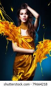 sensual sexy woman in yellow dress and yellow splash