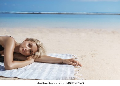 Sensual shot woman face lying sandy beach blanket sunbathing near ocean shore look camera carefree relaxed enjoy summer vacation season, wear bikini wanna take swim sea, perfect holidays