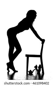 sensual silhouette of a woman standing by a chair on a white background