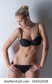 Sensual slender blonde posing in erotic lingerie