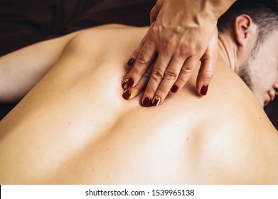 Sensual tantric massage in the cozy atmosphere of a beauty salon by a professional massage therapist
