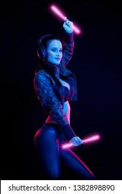 Sensual techno dancer woman in colorful club lighting.