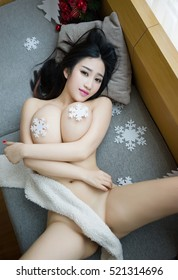Sensual topless naked erotic asian Japanese big tits huge boobs lady stripper pin up girl wearing nothing undressing open legs with white scarf cover private part  and nipples lying in hotel dressless