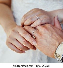 sensual wedding photo of a bridal couple holding hands, groom and bride just happy together