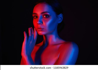 Sensual woman colorful portrait. Beautiful Girl in red and blue bright lights