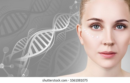 Sensual woman with cream dots on face in DNA chains.