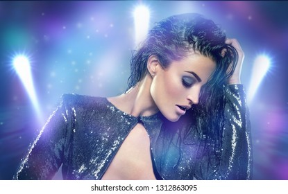 Sensual woman dancing in night club portrait eyes closed, disco