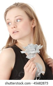 Sensual woman in evening dress with fake silver rose, over white background