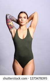 Sensual woman in green bodysuit.