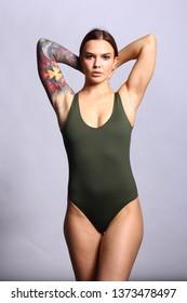 Sensual woman in green bodysuit.