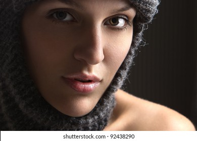 sensual woman in knitted hat posing in studio