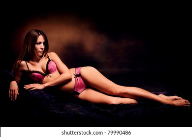 sensual woman in lingerie, studio dark background