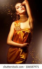 sensual woman in long yellow dress