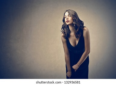 sensual woman on a gray background