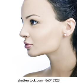 sensual woman portrait with a pearl ear ring, profile, studio shot