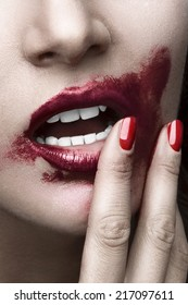 Sensual woman sexy posing. Face close up with red  smeared lips and nails. White skin