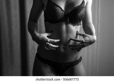 Sensual woman in underwear. Black and white photography.