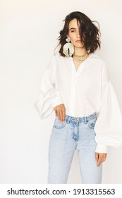 Sensual woman wear puff sleeve shirt. White Shirt, Formal Blouse. Young female in white blouses featuring long puff sleeves. Beads earrings and necklace. Beauty and accessories. Bijouterie.