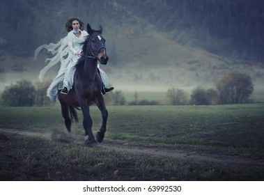 Sensual young beauty riding a horse