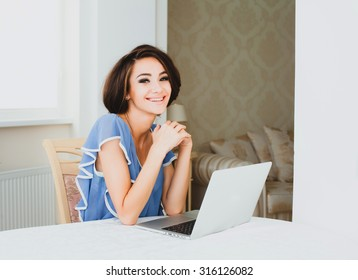 Sensual young lady working at home and waiting for her man after work,young mother resting res hime alone with computer,housewife enjoy her days at home,freelancer work,walking at home