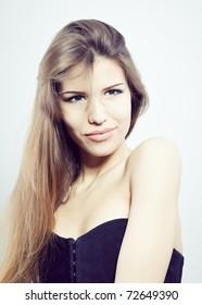 Sensual young woman with beautiful long brown hairs