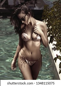 Sensual young woman realxing in a hot tropical water