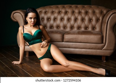 Sensual young woman in a sexy green lingerie