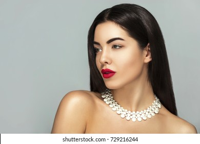 Sensual,Beauty Fashion girl Glamour portrait, Long smooth brunette black hair,Holiday make up,red lips,jewelry