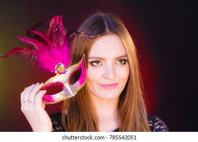 Sensuality celebrations people concept. Sensual lady holding carnival mask. Young woman has amazing and delicate make up.
