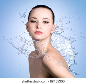 Sensuality young woman with beautiful fresh skin in splashes of water