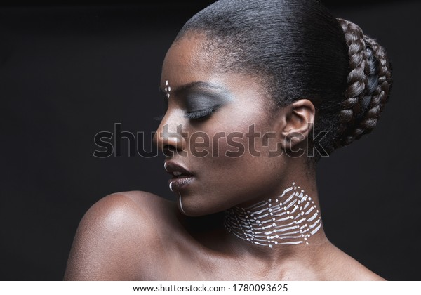 Sensuous African American woman with eyes closed over black background