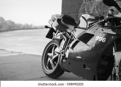 Senta, Serbia: March 4th, 2017. Close-up of beautiful red Ducati 996s motorcycle, photographed outdoor on a dock in Senta, on a public walk way. Sign 996 in focus. Black and white photo.