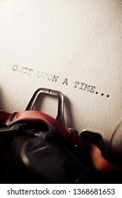 The sentence, once upon a time, written with a typewriter.