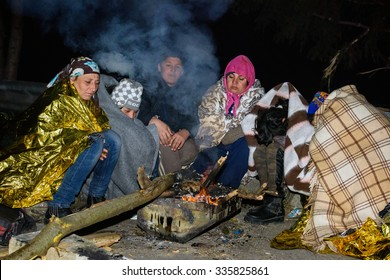 SENTILJ, SLOVENIA - 3 NOVEMBER 2015: Syrian refugees in the no man's land on the Slovenian - Austrian border're burning fire as already freezing outside.