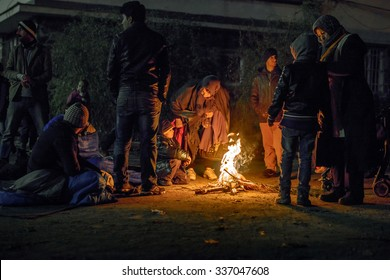 SENTILJ, SLOVENIA - 7 NOVEMBER 2015: Syrian refugees in the no man's land on the Slovenian - Austrian border're burning fire as already freezing outside.