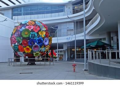 Sentosa, Singapore - July 25, 2019: Portrait of Colourful Flower Tree Sculpture, Harbourfront Centre, Vivo City, Sentosa, Singapore.