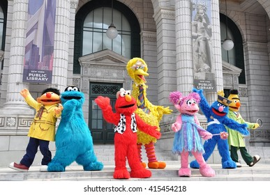 Sentosa, Singapore - June 11, 2014: Sesame Street characters are performing in front of the crowds at Universal Studio Singapore.