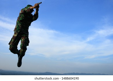Sentul, West Java, Indonesia - May 19th, 2011: Jump and shoot, Indonesia's UN Peacekeeper troops