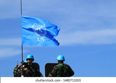 Sentul, West Java/Indonesia - May 18th, 2011: Indonesia's UN Peacekeeper with UN flag on the left side